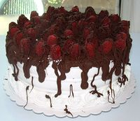 White Chocolate Wonderland Cake with Raspberry Bavarian Cream Filling, American Style Whipped Icing, Oozing with Ganache Covered Raspberries