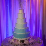 Winter Ice Blue Ombre cake with feather topper
