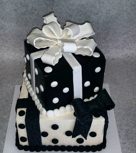 2 tiered black and white package cake