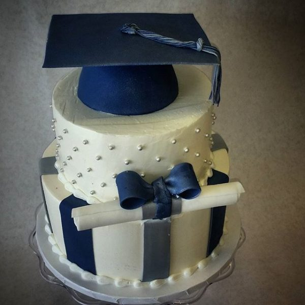 Tiered graduation cake with school colors and diploma
