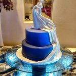 Wedding dress flowing down cake