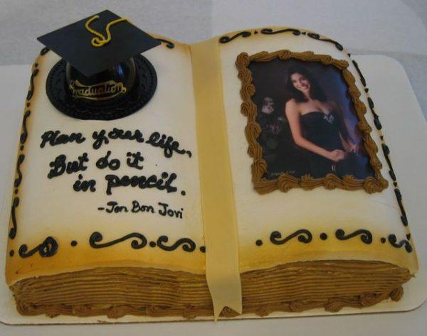Beautiful graduation book cake with photo