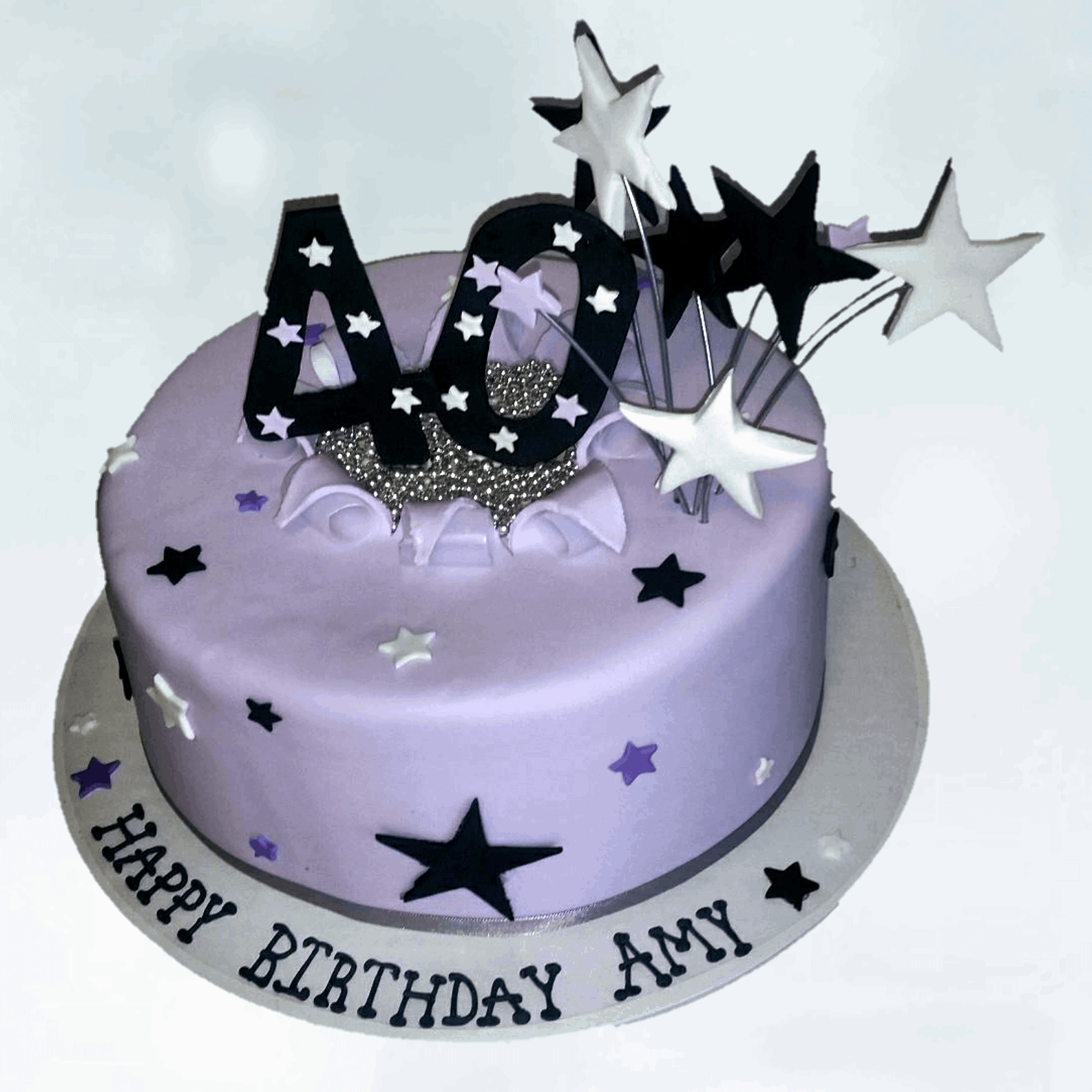 Number 40 and stars burting through a lavender fondant covered cake with stars on the face of the cake