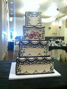 Elegant black and white with red wedding cake at Bella Sera Event Center in Brighton
