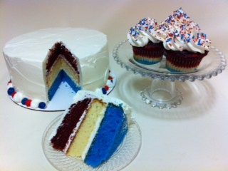 A Red White and Blue layered cake and Cupcakes