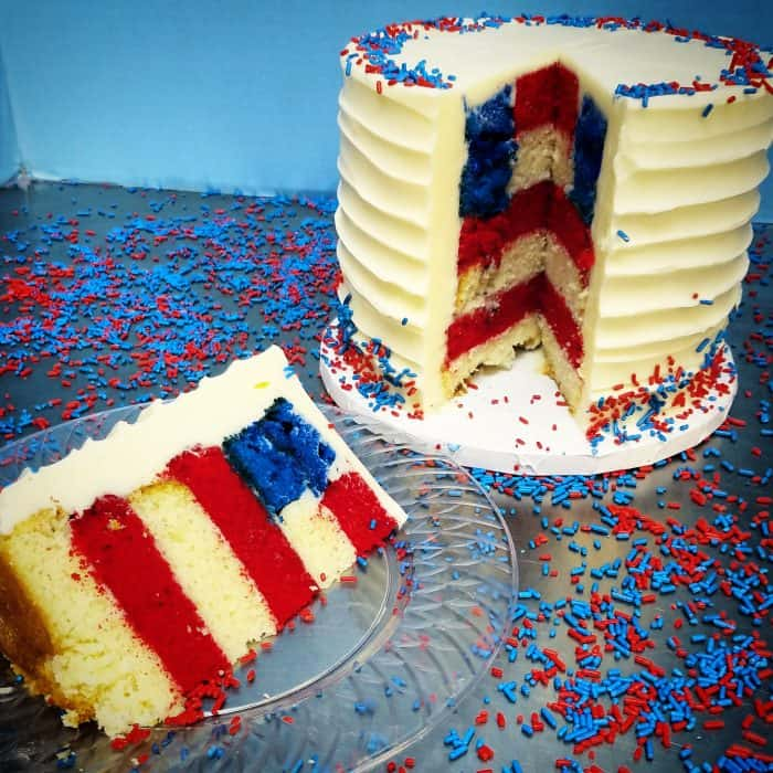 White texture frost cake cut open to reveal American flag