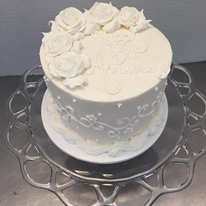 Anniversary Cake Done in White with Roses and Scrollwork