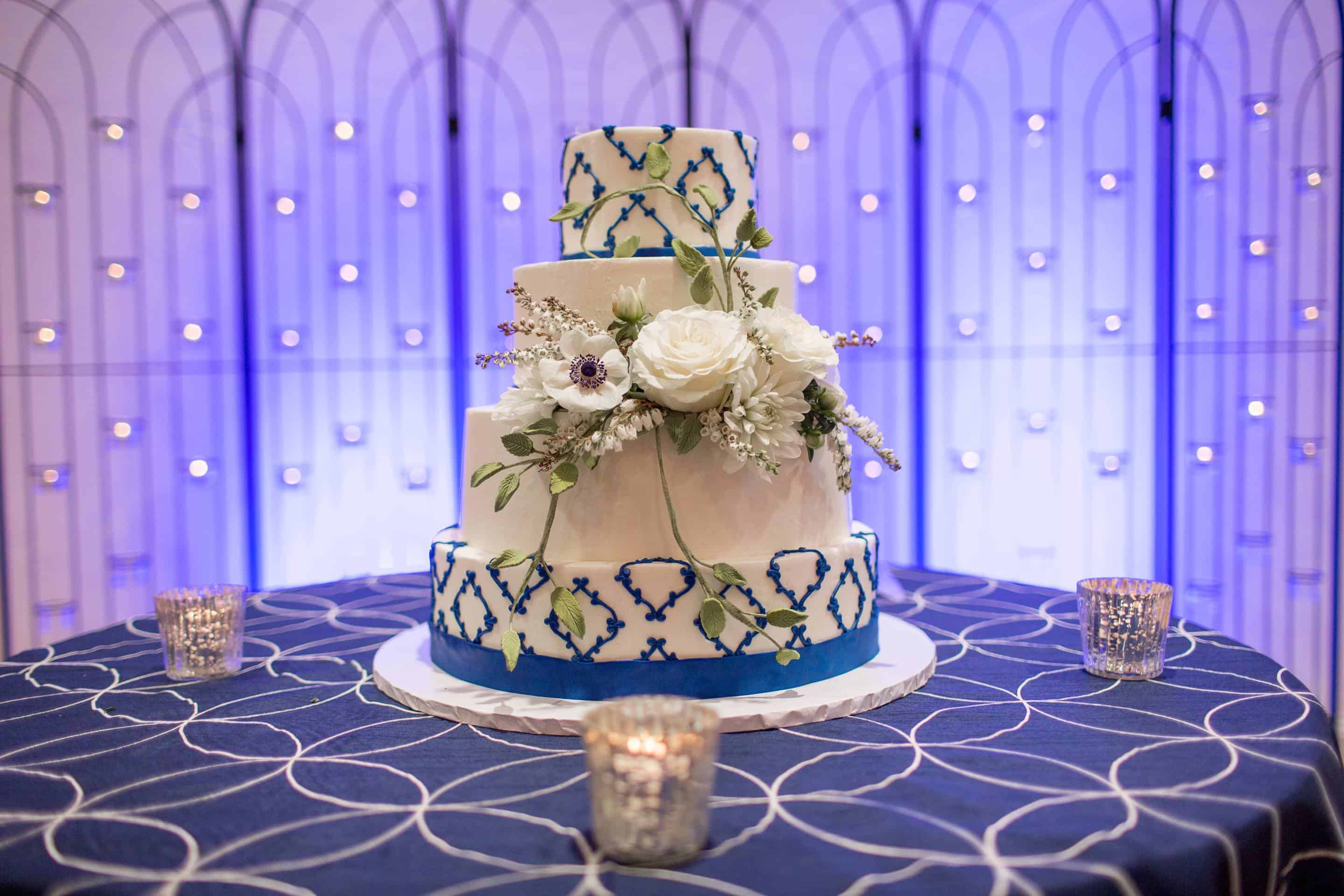 Blue and White Wedding Cake with Diamond Design and Blue Uplighting