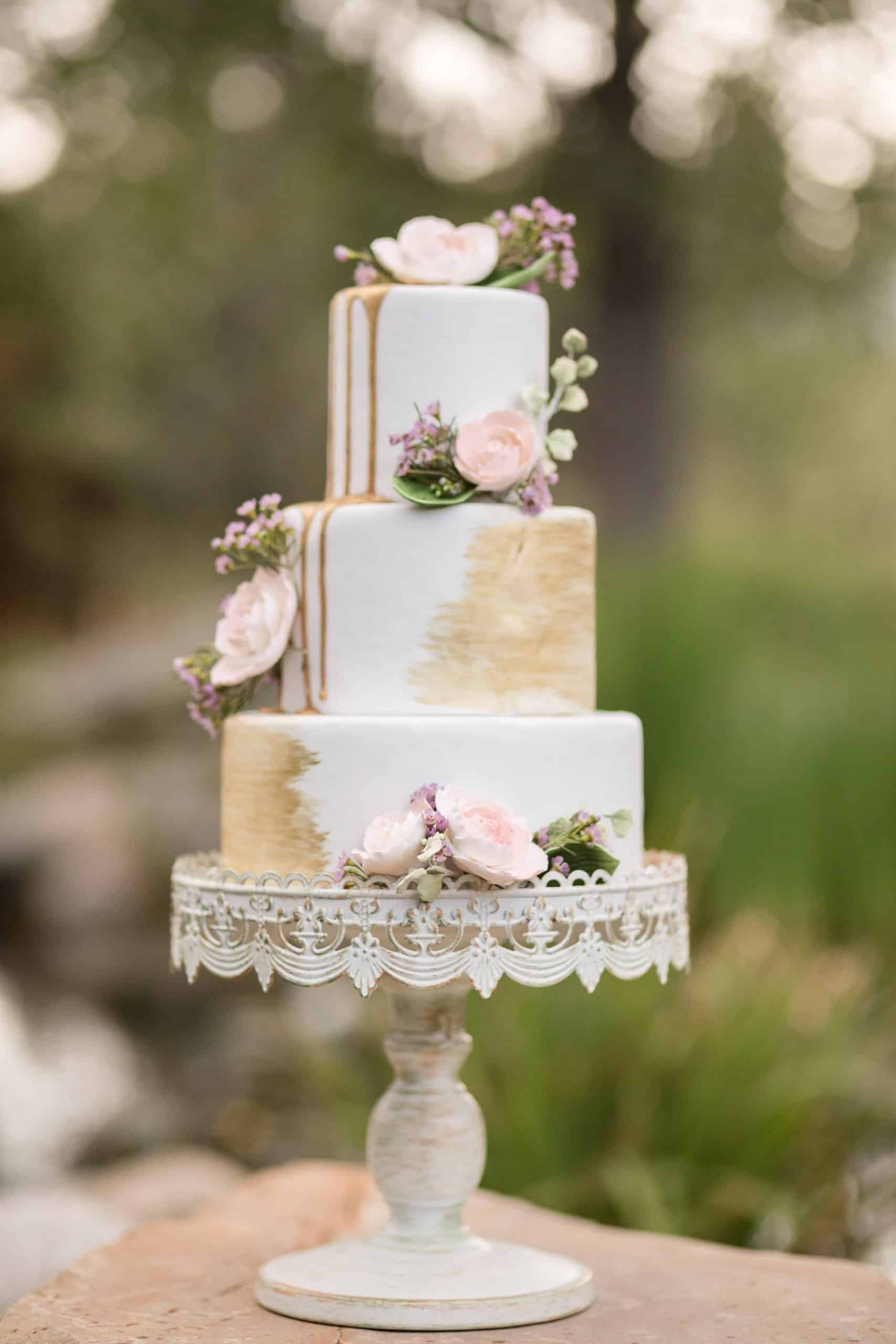 Gold Drip Wedding Cake with Vintage Stand