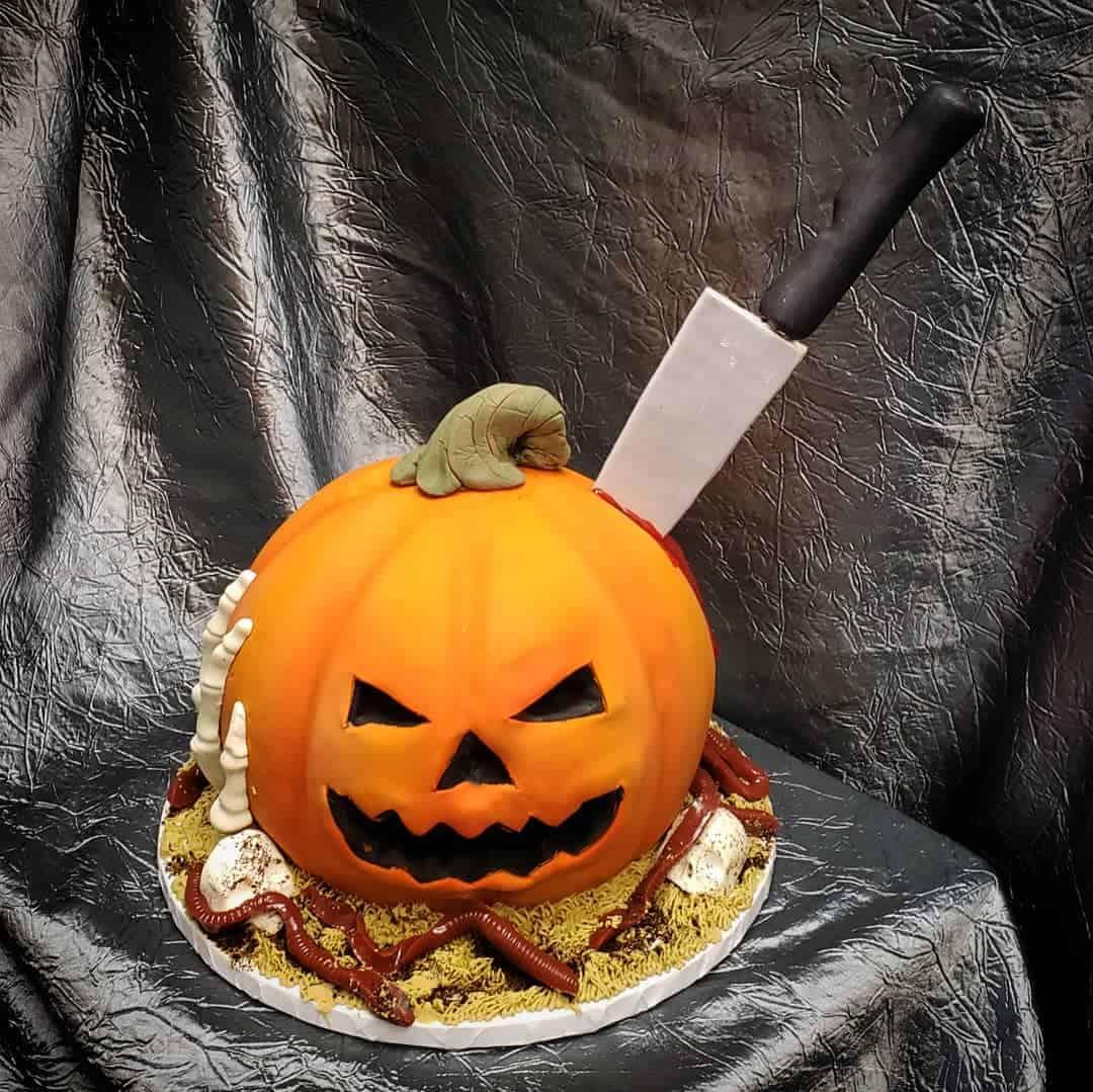 Gory Jackolantern with Knife Sticking Cake