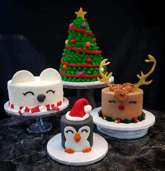 Holiday Cakes 4 different Cakes, a polar bear in a scarf, and penguin with a santa hat, and a red nosed reindeer