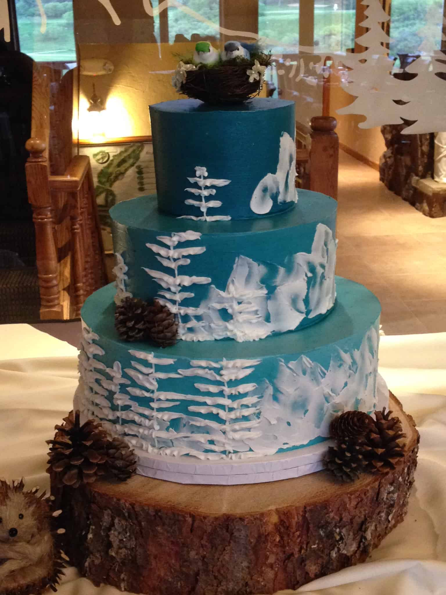 Mountain Scene Ombre Colored Wedding Cake with Trees and Mountain