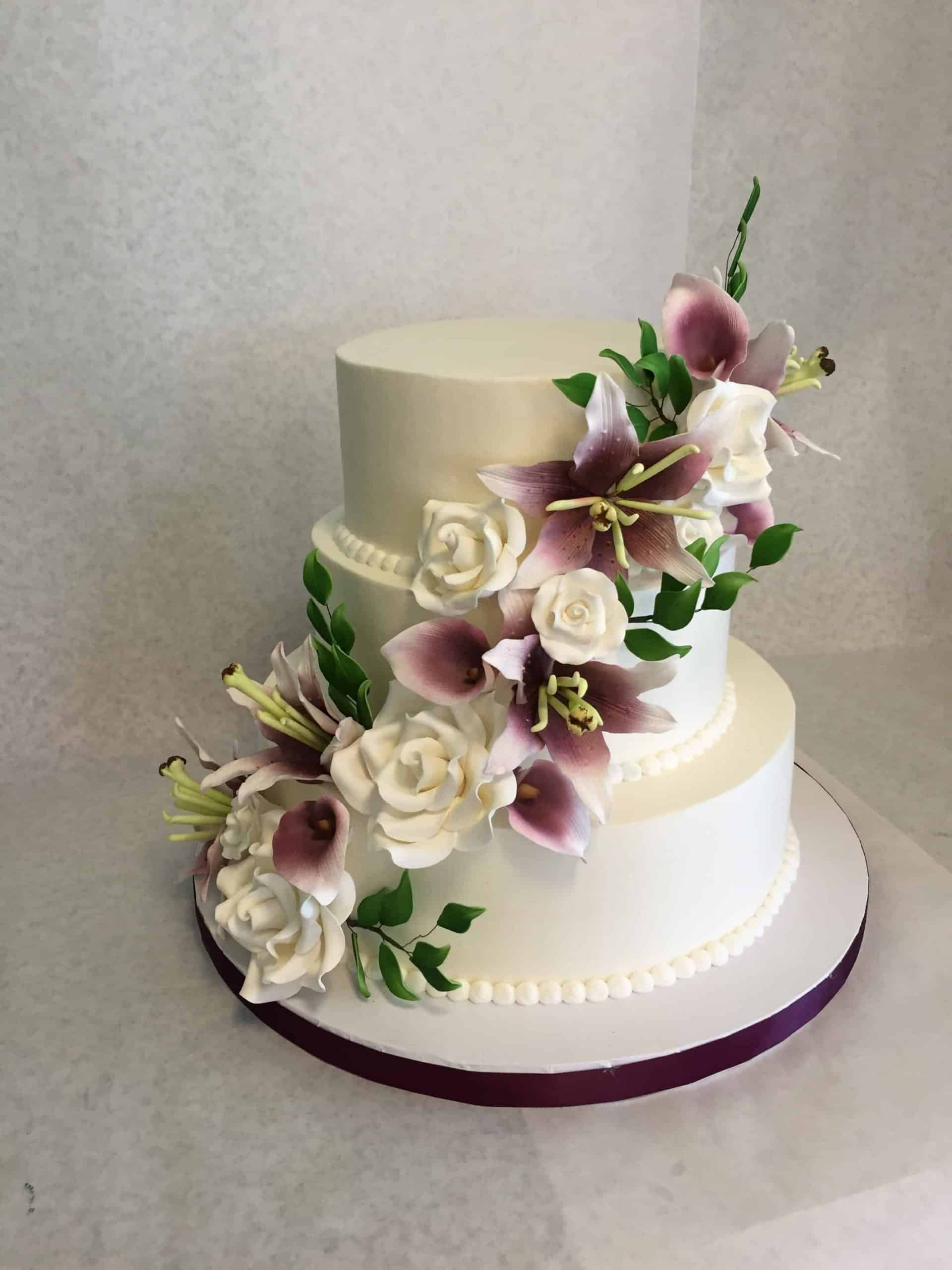 Sugar Flower Cascade Wedding Cake done in White and Wine Colors