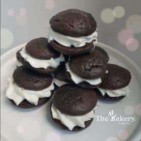 whoopie pies buttercream sandwiched between 2 pieces of cake