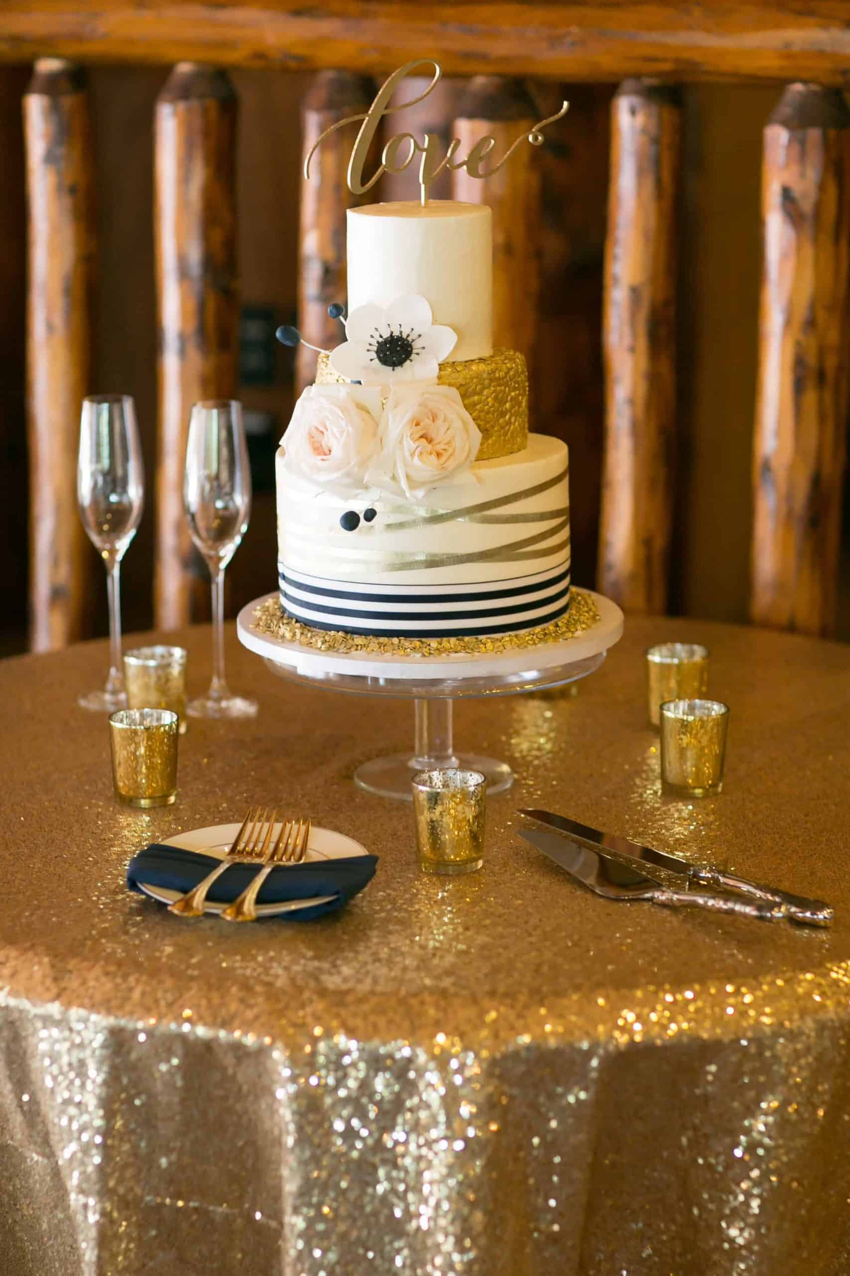 Wedding Cake with Gold Tier and Gold Ribbon Alison Emerick Photography