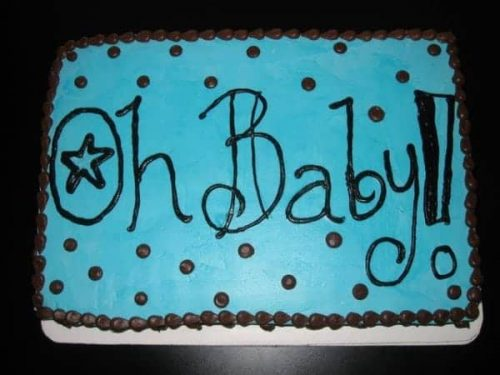 "Baby Shower Cake Iced in blue buttercream with ""OH Baby"" written on top"