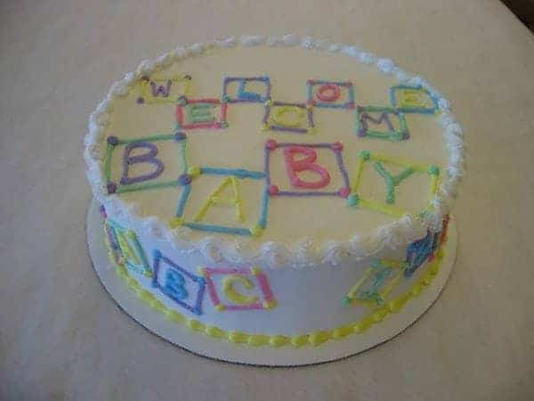 Baby Shower Cake With Buttercream Blocks piped on top and around the cake