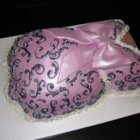 Pink Cake shaped like a pregnant torso