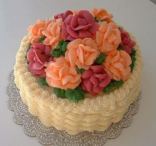 A Buttercream Basket weave on the side with buttercream Roses on the top of the Cake