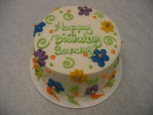 Birthday Cake with funky flowers (a piped a pedal flower), piped swirls, and dots