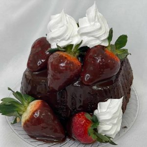 chocolate cake with the perfect chocolate sauce, dipped berries and whipped cream