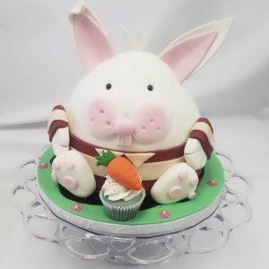 bunny cake eating a cupcake
