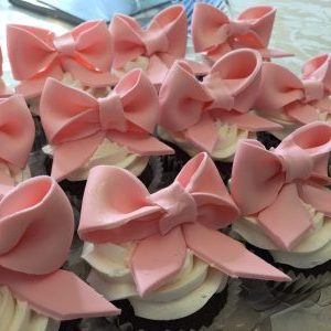 cupcakes with sweet little pink bows