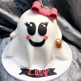 cute ghost cake with pink bow and handbag