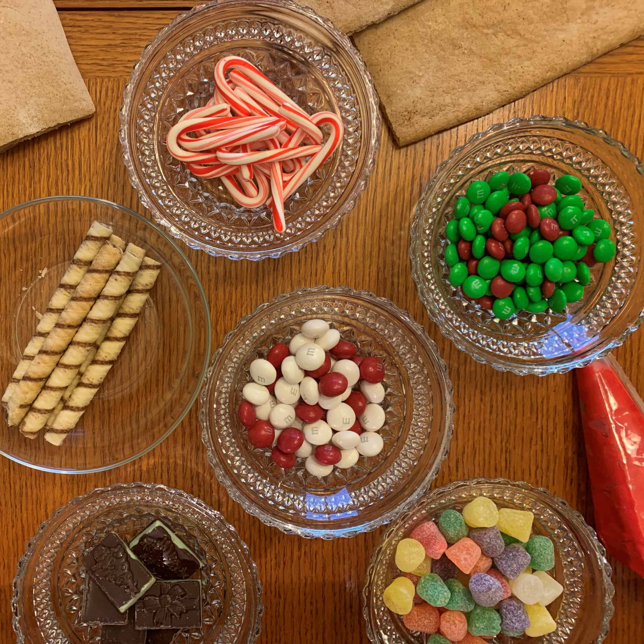 Gingerbread house components such as candy, cookies, and icing