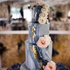 marble wedding cake with gold leaf in Colorado