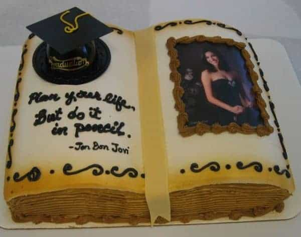 Cake in the Shape of an open Book with an Edible image photo on the right and a plastic graduation cap and message on the left