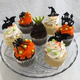 Halloween cupcakes with plastic Spider, Bay, Ghost, Witch hat, and Zombie Hands picks
