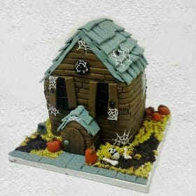 Haunted House cake with graveyard