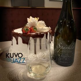 Cake with wine bottle and glass