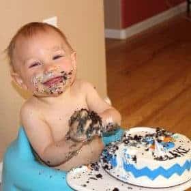 baby and first birthday smash cake