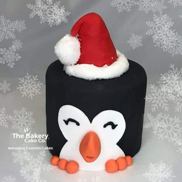 Cute penguin cake with santa hat