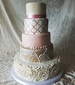 5 tiered wedding cake in various color and texture