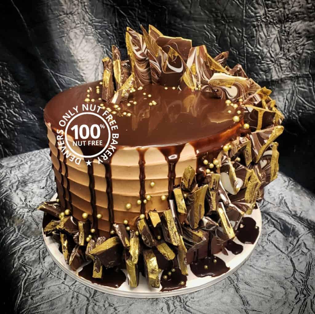 Chocolate cake with nut free bakery logo