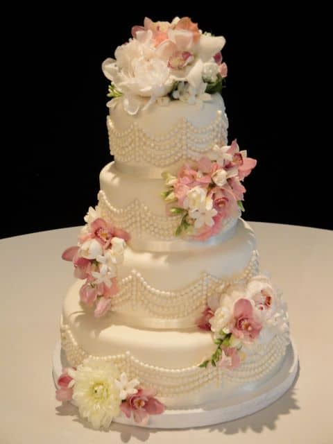 Pearl Swag Wedding Cake with Soft Pink and White Flowers and Ribbon