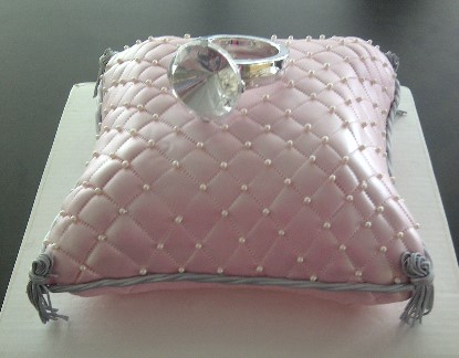 Pillow Cake with a Ring on Top