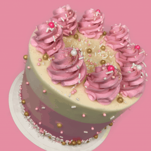 pink birthday cake with lots of frosting