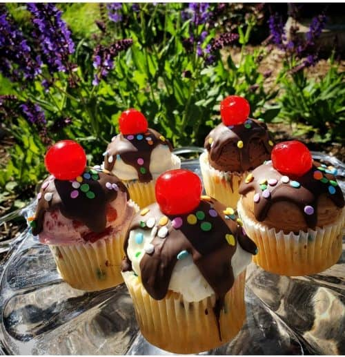 Sundae Cupcakes topped with ganache and a cherry