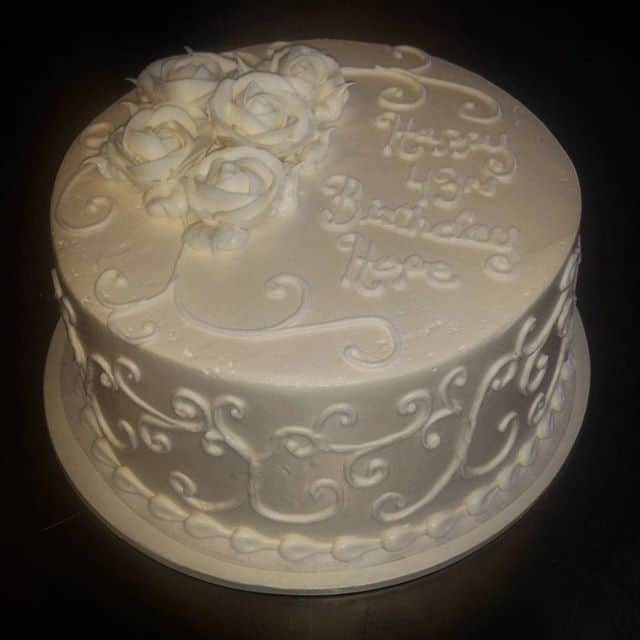 Simple White Scroll and Roses Engagement Cake
