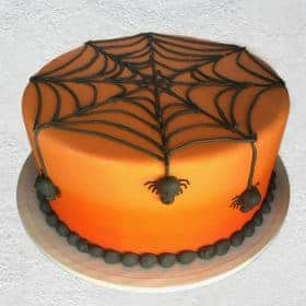 orange cake with spiders and web