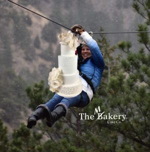 Woman ziplining with cake