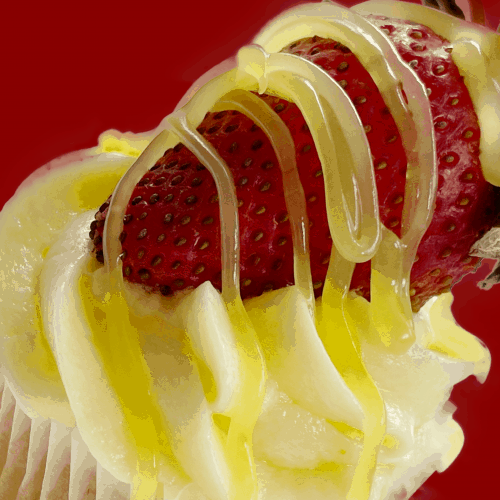 Cupcake with a fresh strawberry and lemon topping