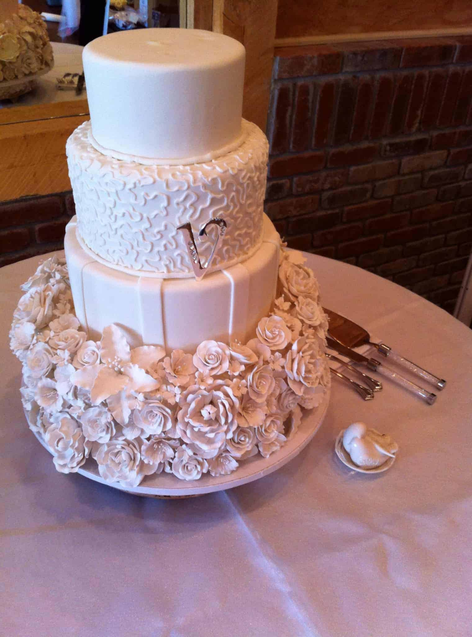 Sugar Flower Covered Tier Wedding Cake with Stripes and Lace