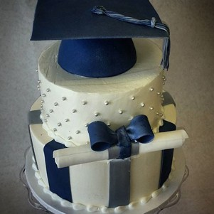 Graduation Cake with Cap and Diploma Tied with a Bow