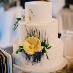 White wedding cake with black water color